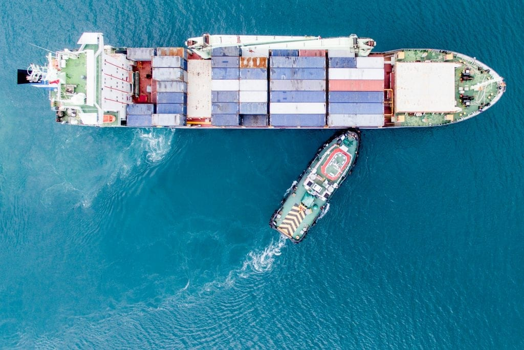 Aerial Photography of Container Ship and Tug Boat